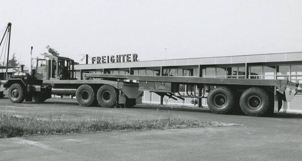 Pictured in front of the Freighter offices, this Tandem axle flat top Freighter trailer is ready for a customer delivery. Photo circa 1960s.